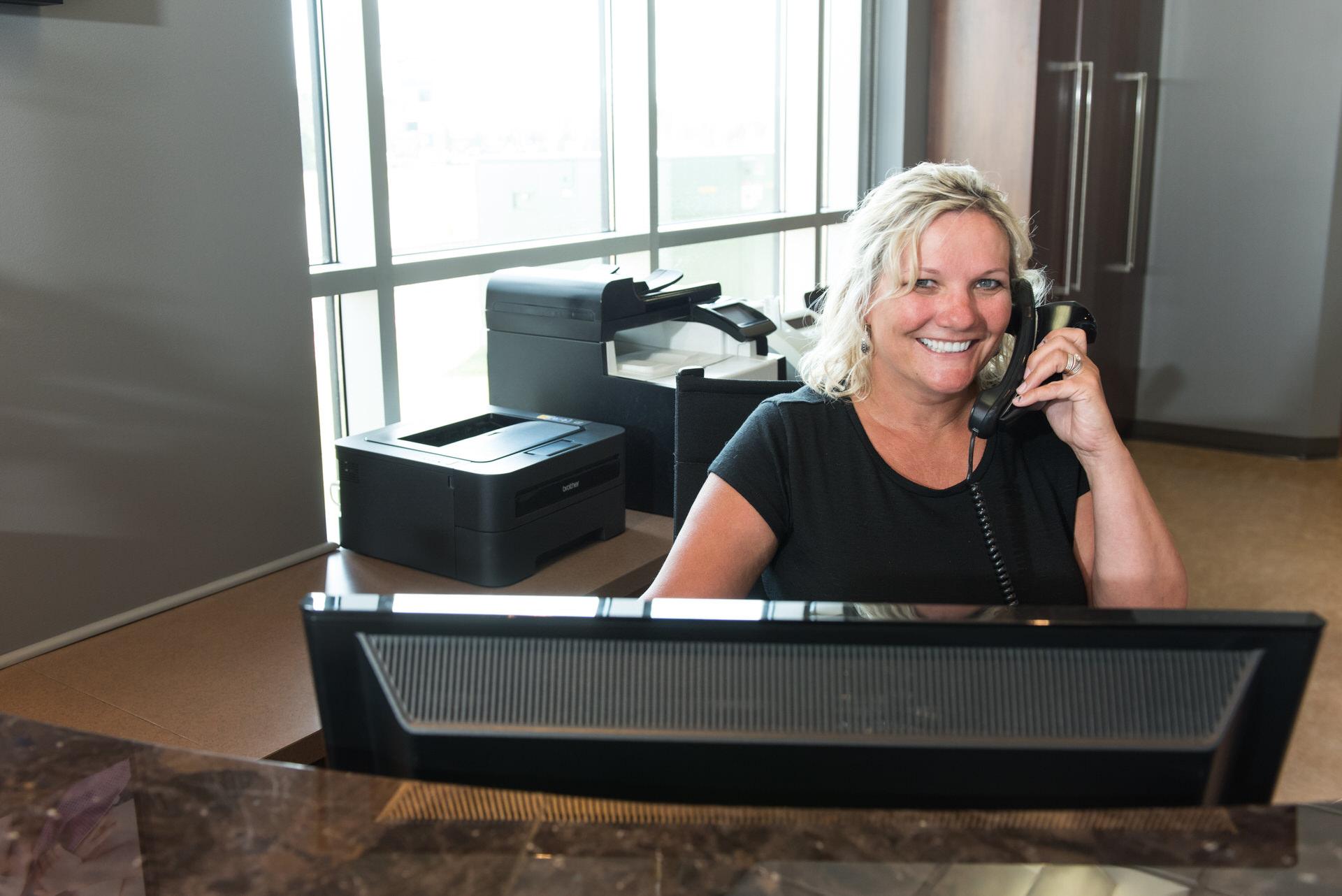 dental-staff-answering-phone-call